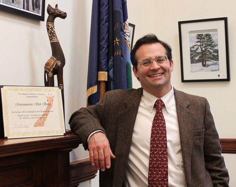House Majority Leader Seth Berry in his office after winning a 2014 Champions for Children Giraffe Award from the Maine Children's Alliance.
